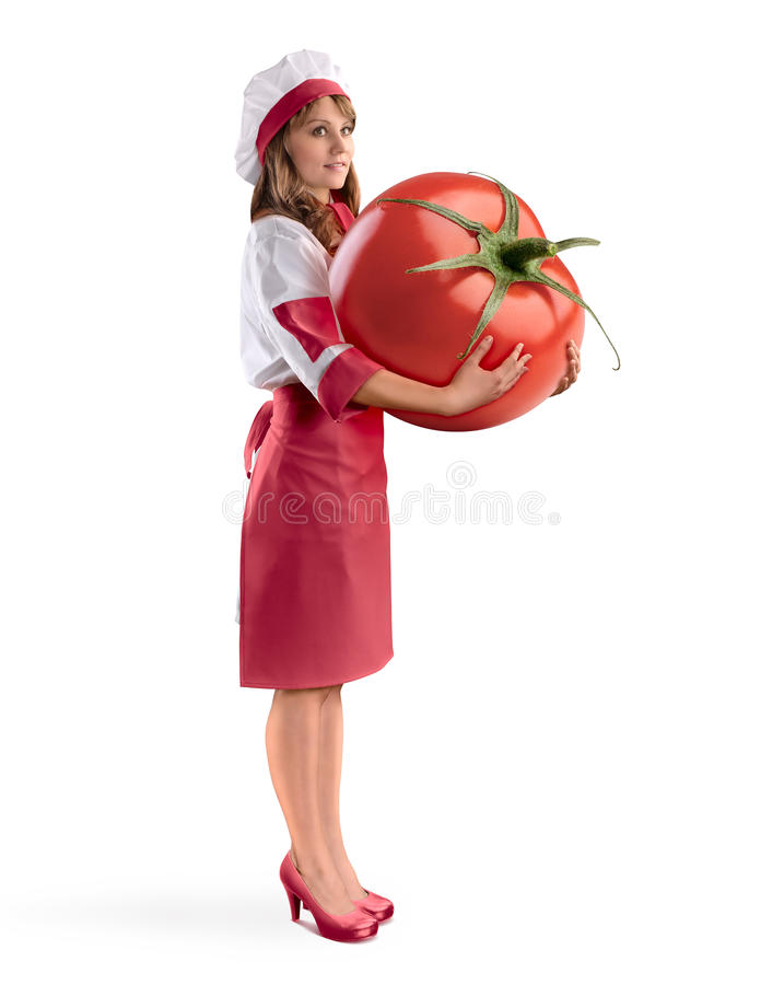 Cook girl chef holding a large tomato on isolated background. Cook girl chef holding a large tomato on white isolated background stock photos