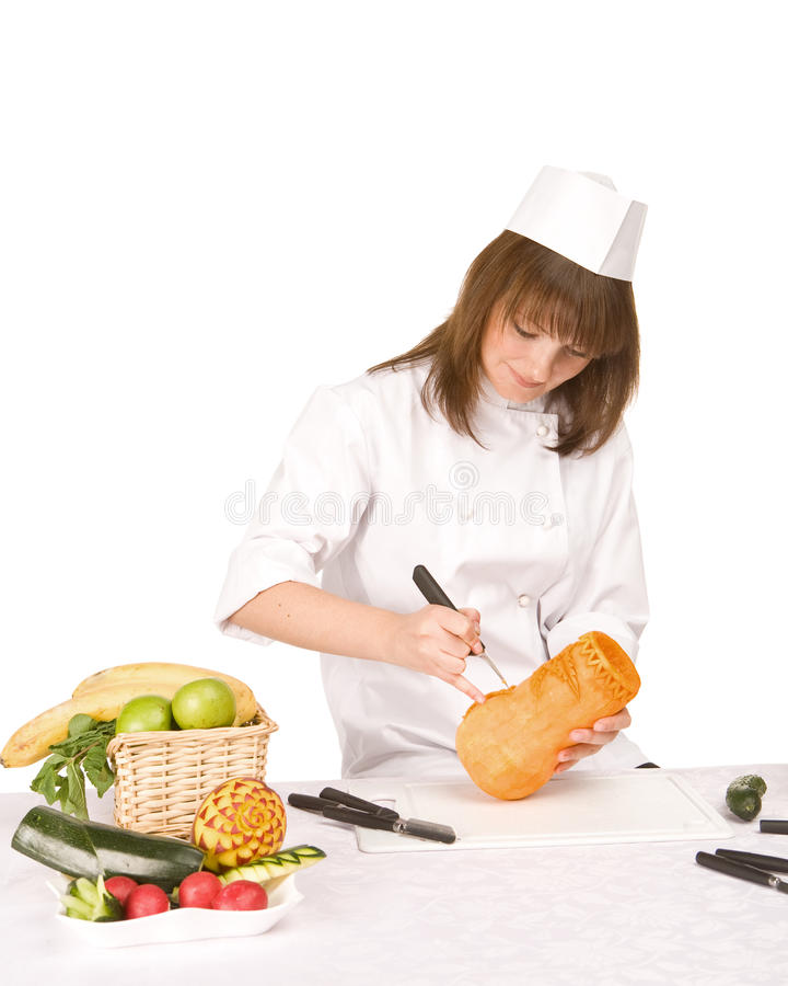 Cook Girl Makes Carving A Pumpkin Vase Stock Photography