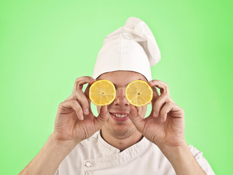 Cook with halves of lemon royalty free stock images