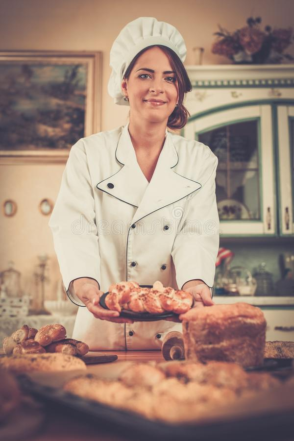Cook holding baked goods. Woman cook holding homemade baked goods royalty free stock photo