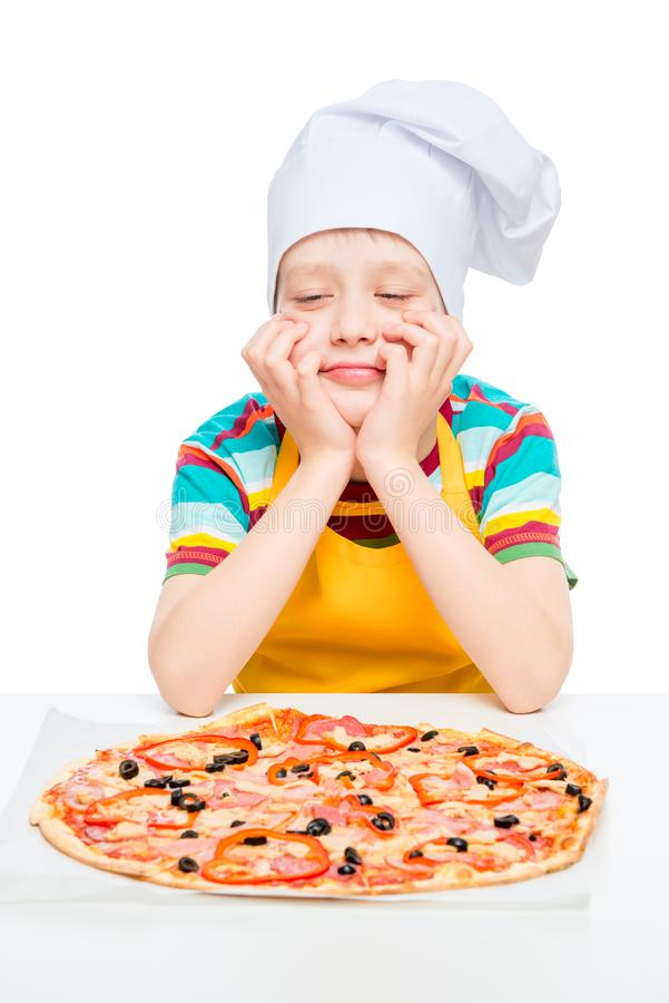 cook with homemade pizza, boy 10 years old, portrait on white background stock image