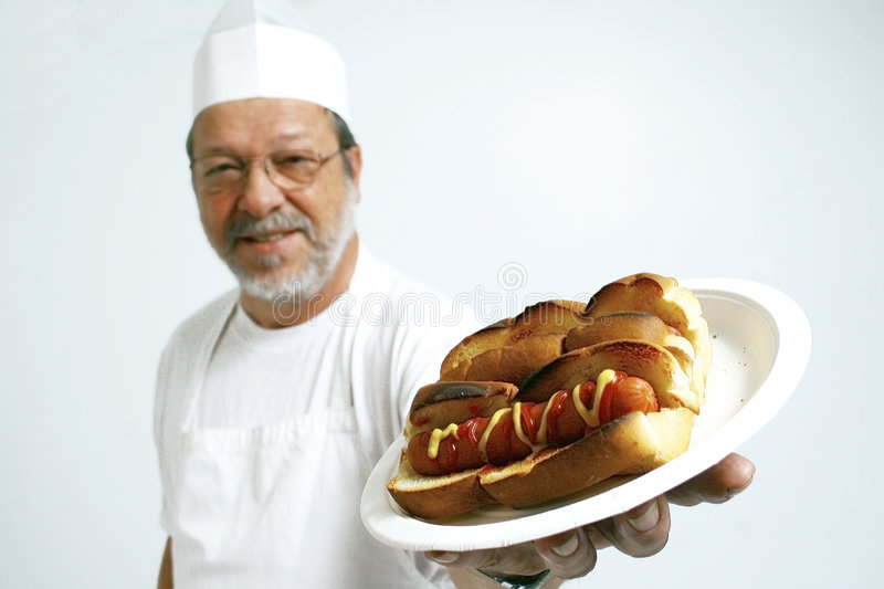 Cook with hot dogs royalty free stock photo
