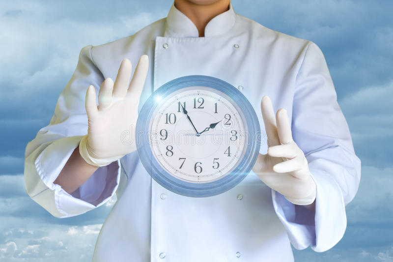 Cook keeps in the hands of the clock. stock photos