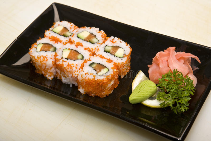 Cook on kitchen prepares Japanese susi stock images