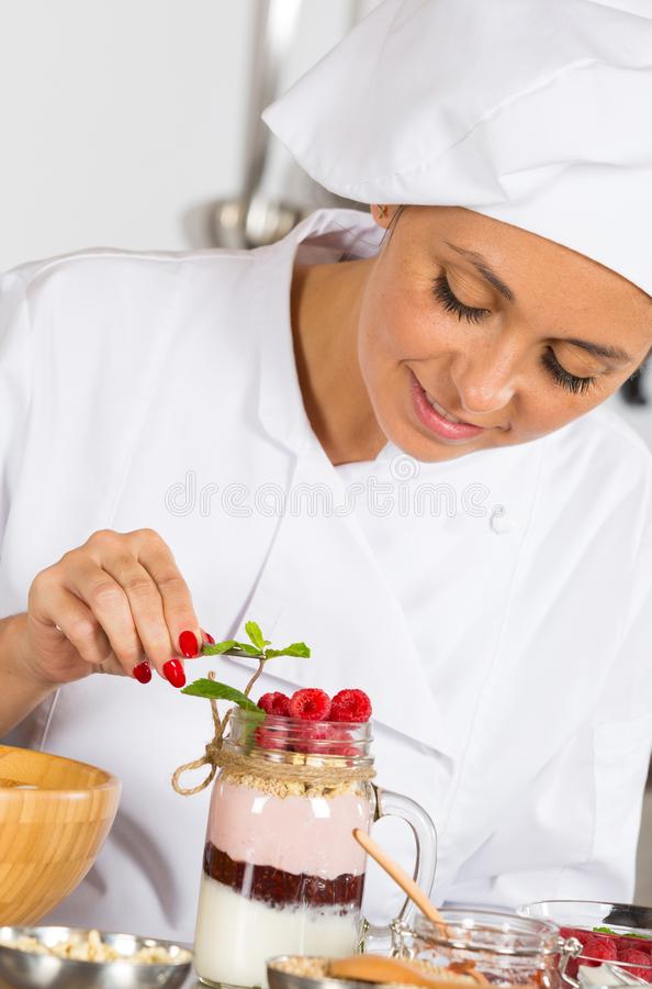 Cook making a dessert royalty free stock photo