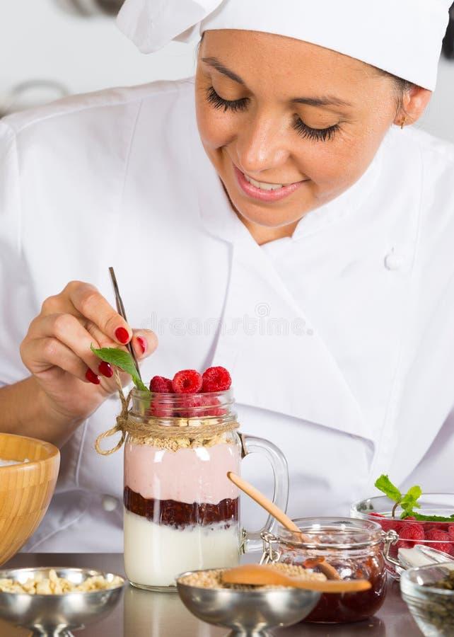 Cook making a dessert stock photos