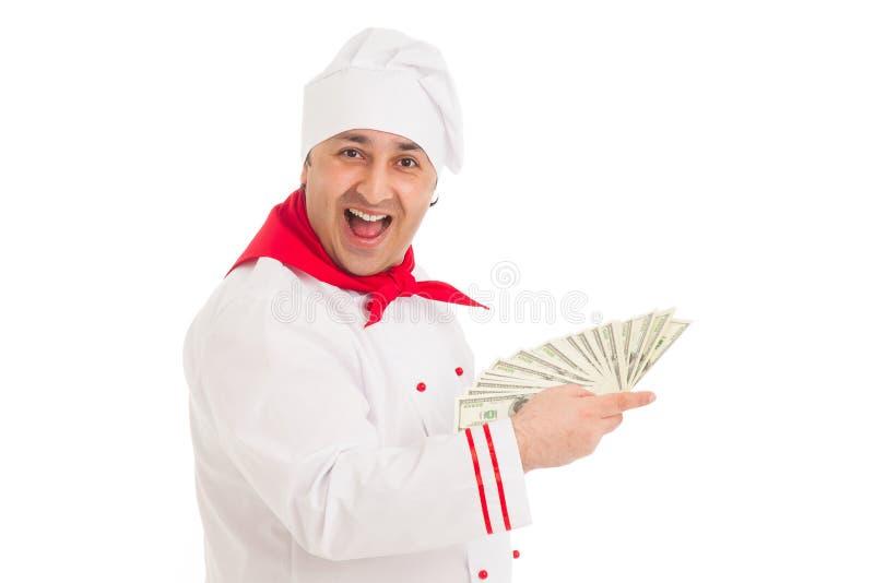 Cook Man Holding Fan Of Dollars Wearing White Uniform Royalty Free Stock Photo