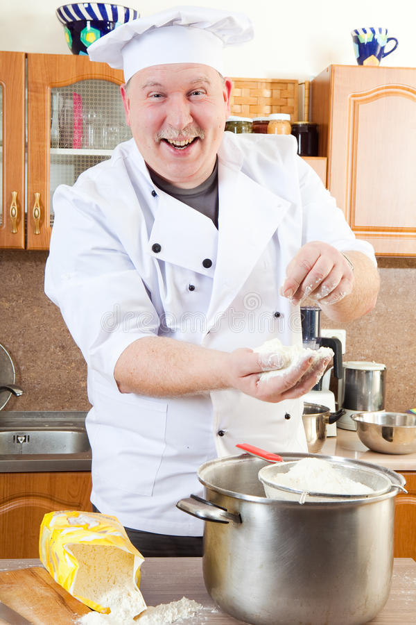 Cook man in kitchen. Cook man mixing flower for cookies stock images