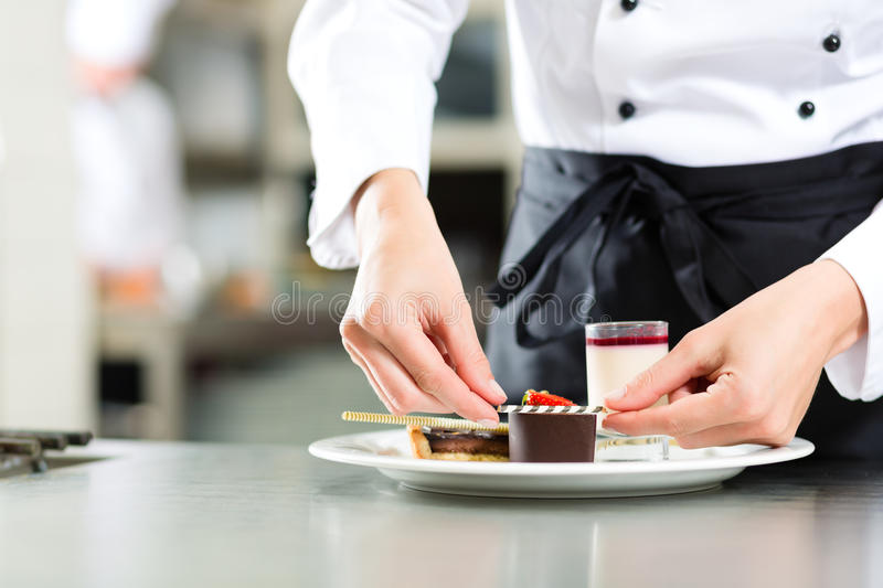 Cook, pastry chef, in hotel or restaurant kitchen stock photo