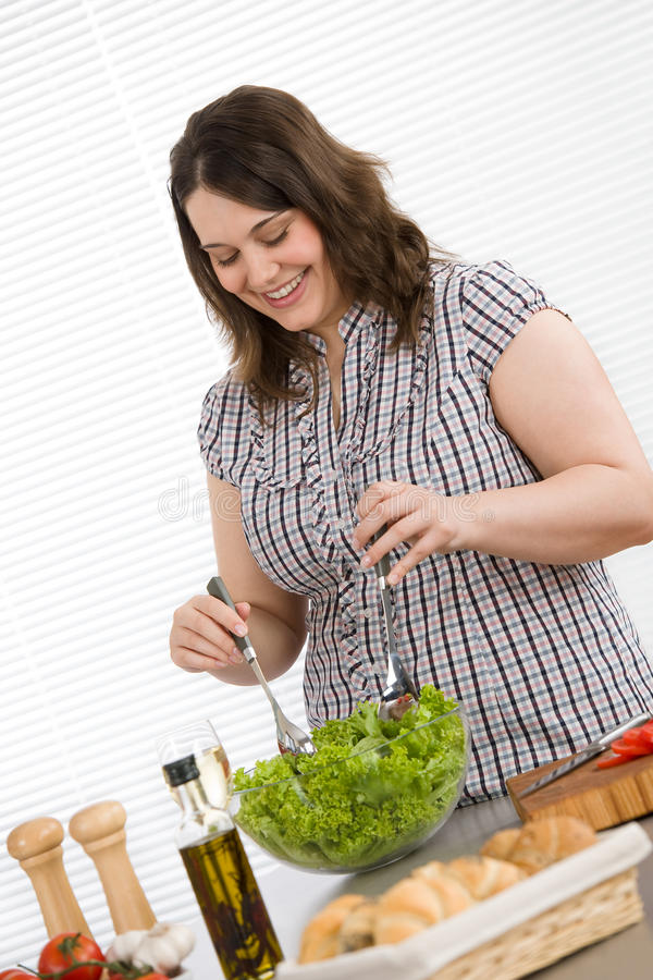 Download Cook - Plus Size Happy Woman Preparing Salad Stock Photography - Image: 14331682
