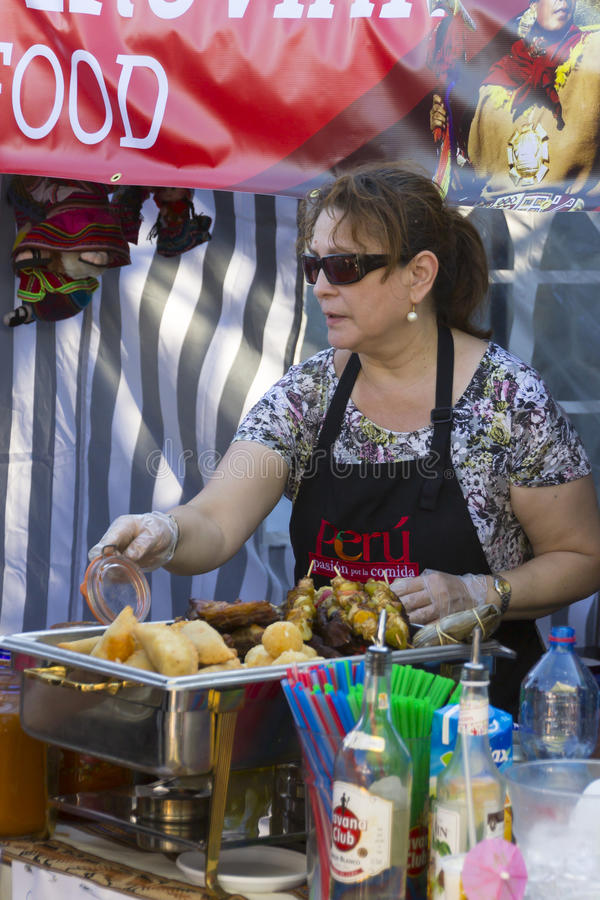 A cook at the popular Naplavka street food festival in Prague royalty free stock photo