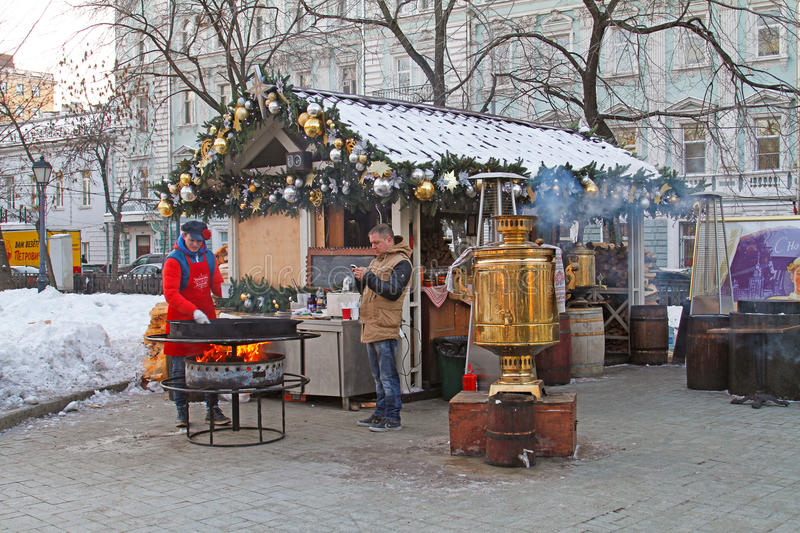 The cook prepares food for visitors of the Festival `Journey to Christmas` on Tverskoy Boulevard stock images