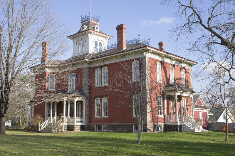Cook-Rutledge Mansion in Chippewa Falls. Cook-Rutlege red brick historic mansion in Chippewa Falls Wisconsin of the High Victorian Italianate architectural style stock photos