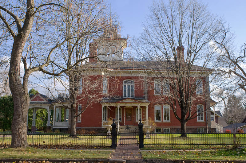 Cook-Rutledge Mansion in Chippewa Falls. Cook-Rutledge red brick historic mansion in Chippewa Falls Wisconsin of the High Victorian Italianate architectural stock image