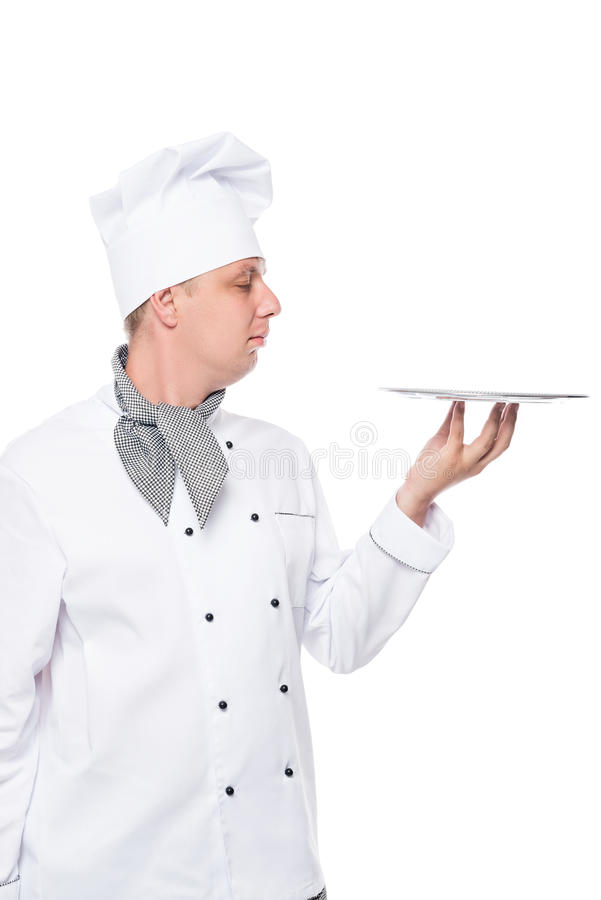 Cook in a suit holding an empty tray on a white stock image