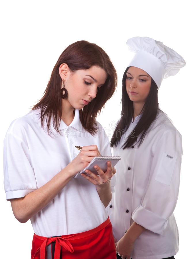 Cook and waitress talk. Service and cook together to discuss the menu royalty free stock images