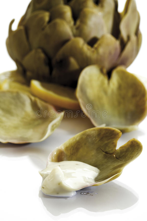 Cooked artichoke with Aioli-Dip, close-up royalty free stock image