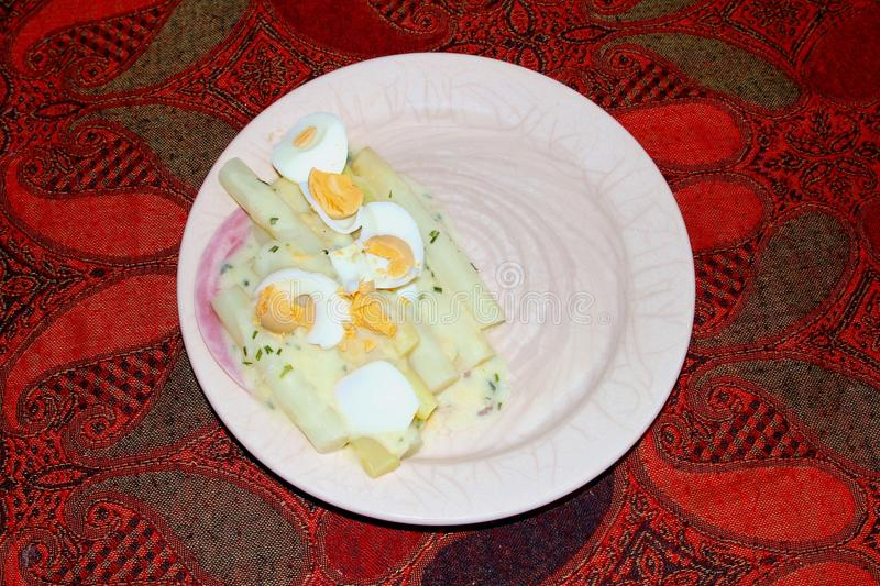 Cooked asparagus eggs ham plate dish table, Netherlands stock photography