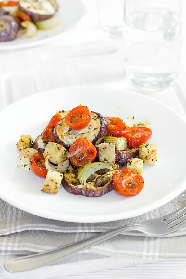 Cooked aubergine. With tofu and tomatoes royalty free stock photo