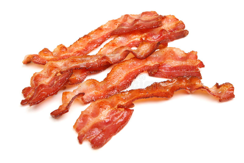 Cooked Bacon Strips Isolated on White stock photos