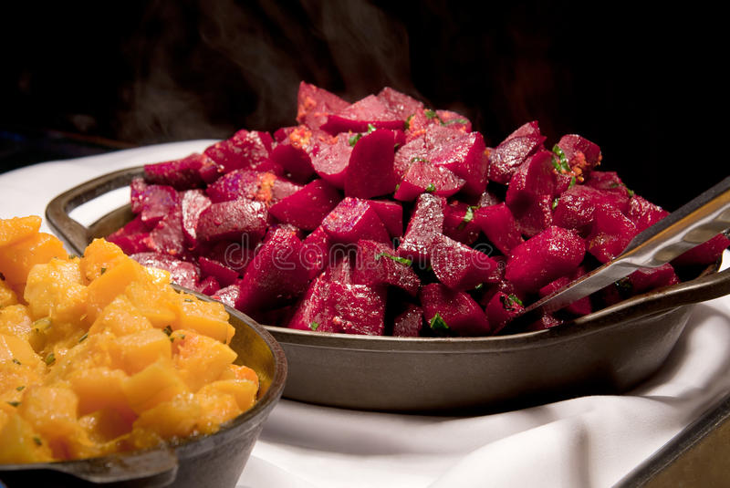 Cooked Beets. And sweet potatoes on a buffet table stock photography