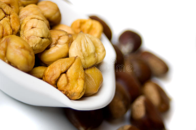 Cooked chestnut served in bowl. Isolated on white background stock photography