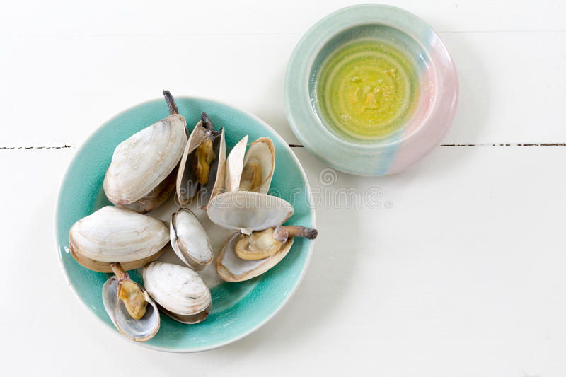 Cooked clams. With melted butter stock photos
