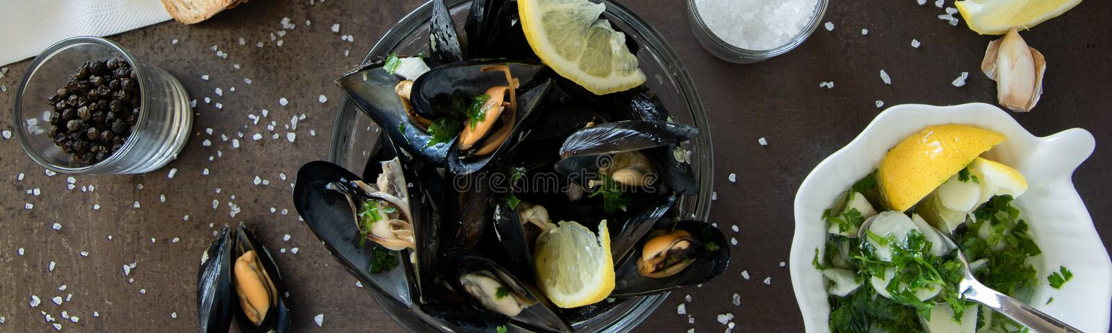 Cooked delicious black mussel with toasted bread and tasty sauce. Healthy eating concept,  protein  food stock image