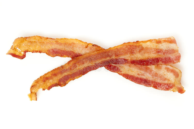 Cooked Greasy Bacon. Against a back ground royalty free stock images