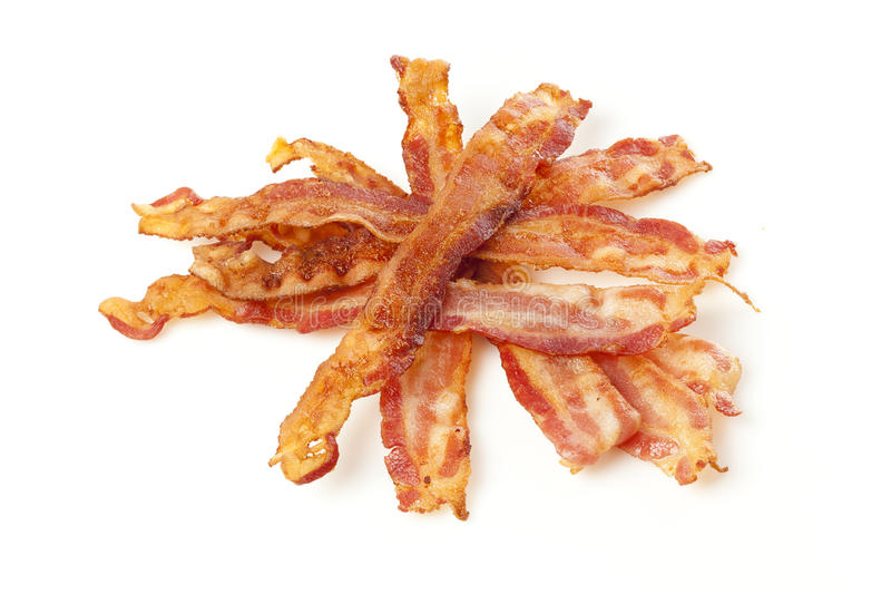Cooked Greasy Bacon. Against a back ground stock photo