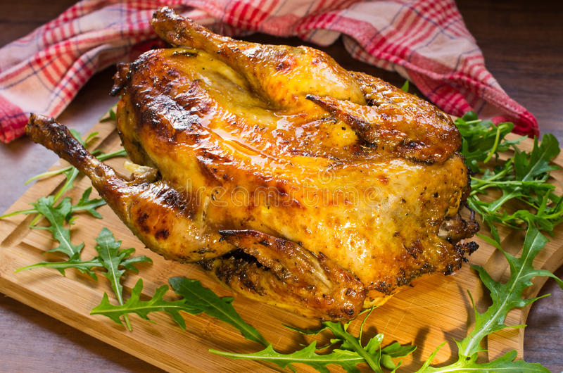 Cooked guinea fowl bird. Guinea fowl bird cooked in the oven royalty free stock images