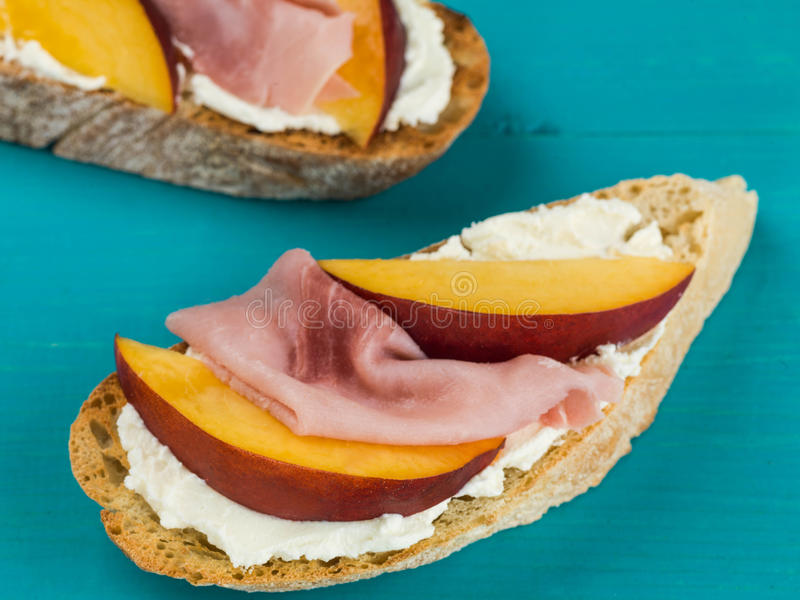 Cooked Ham and Fresh Sliced Peaches With Soft Ricotta Cheese on Ciabatta Sandwich royalty free stock photography