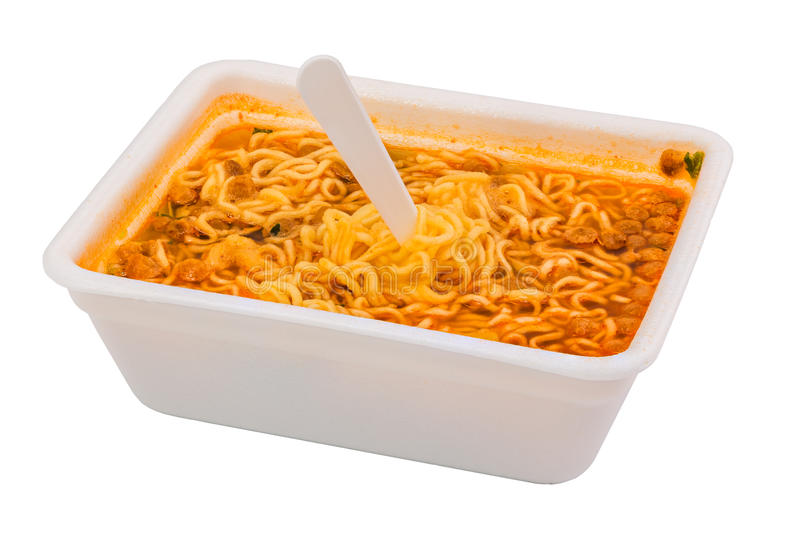 Cooked instant noodle in rectangular cup and fork stock photos
