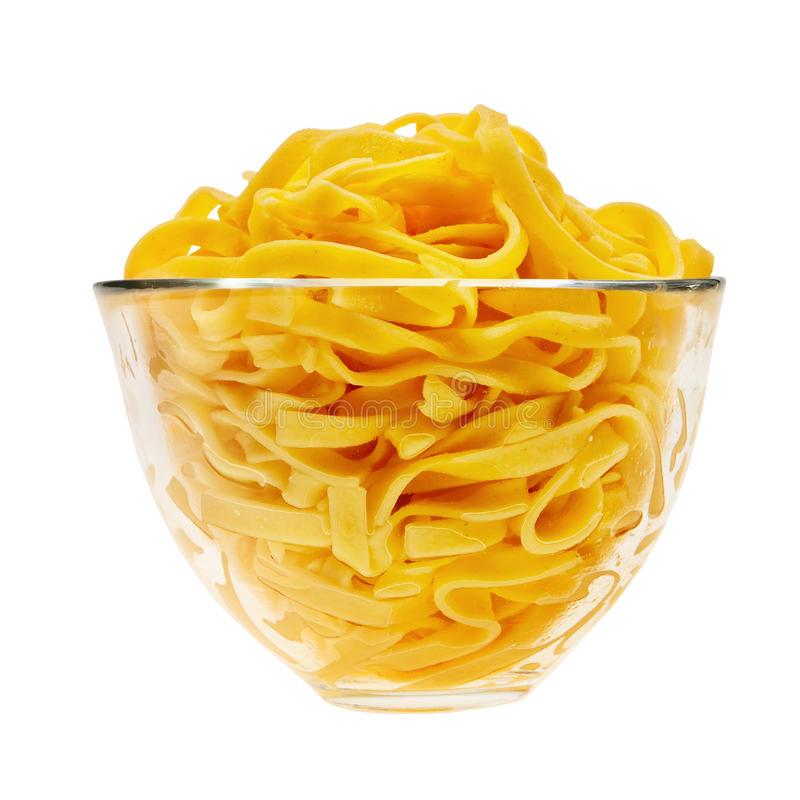 Cooked italian pasta in glass transparent bowl. Cooked italian pasta in glass transparent bowl isolated over white background royalty free stock images