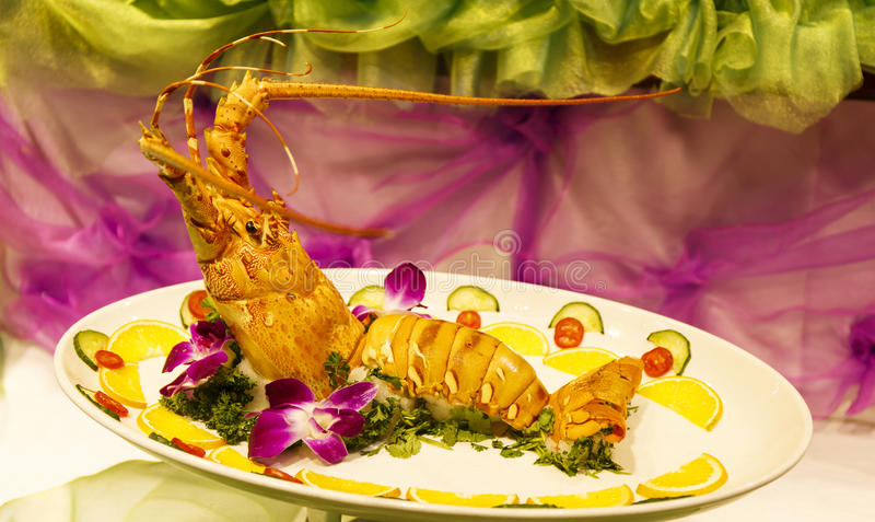 Lobster Asian Chinese food cuisine. Famous delicious exotic Asian traditional Chinese cuisine food in China Asia. Cooked lobster with parsley, lemon slices and stock images