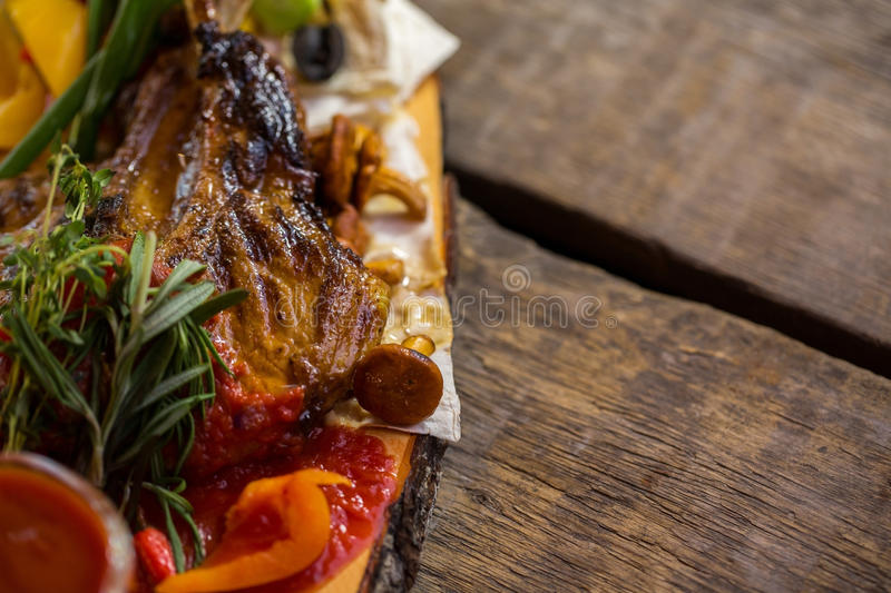 Cooked meat with sauce. Small mushroom on pita. Proven recipe of grilled pork. Meal in the village royalty free stock photo