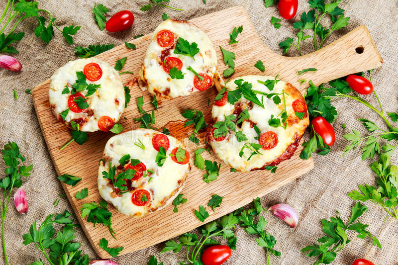 Download Cooked Mushrooms Stuffed With Cheese And Plum Tomatoes Stock Photo - Image of cook, lunch: 69991102