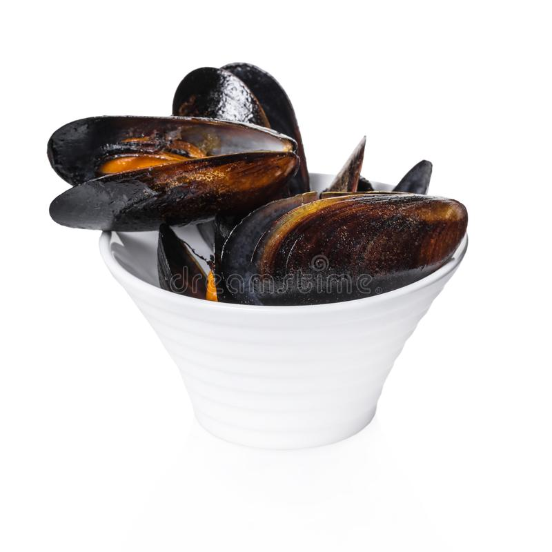 Cooked mussels in a bowl. On white isolated background royalty free stock image