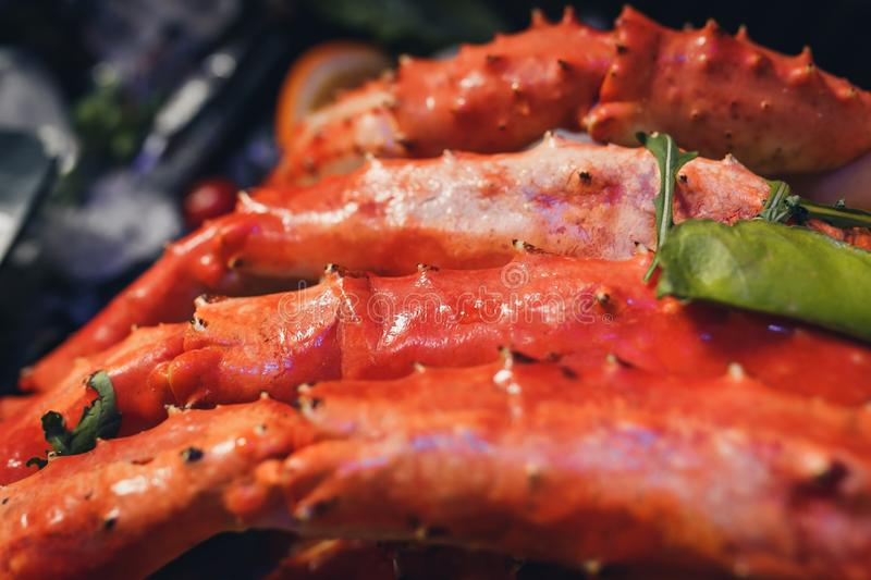 Cooked Organic Alaskan King Crab Legs with Butter royalty free stock images