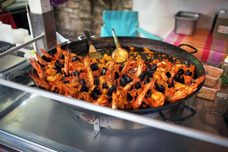 Paella. street food. seafood dish: mussels and shrimp stock photography