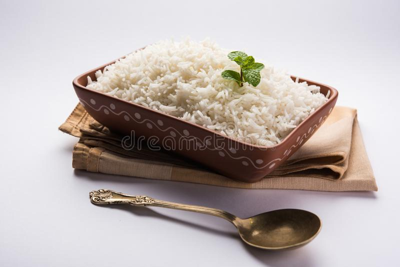 Cooked plain white basmati rice in terracotta bowl, selective focus. Cooked plain white basmati rice in terracotta bowl over plain or wooden background royalty free stock photos