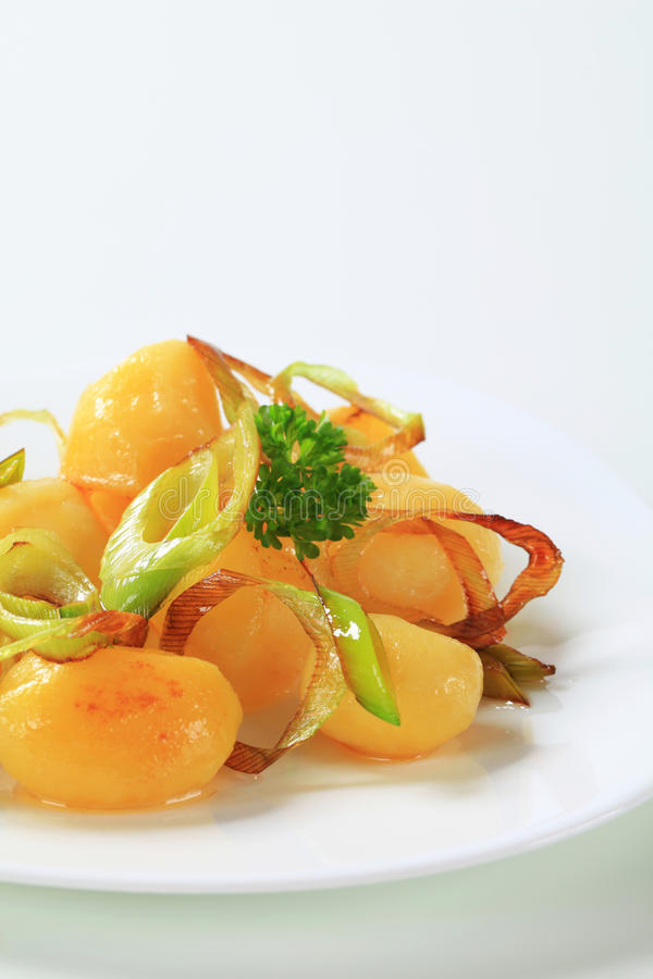 Cooked potatoes. With pan fried onion stock images