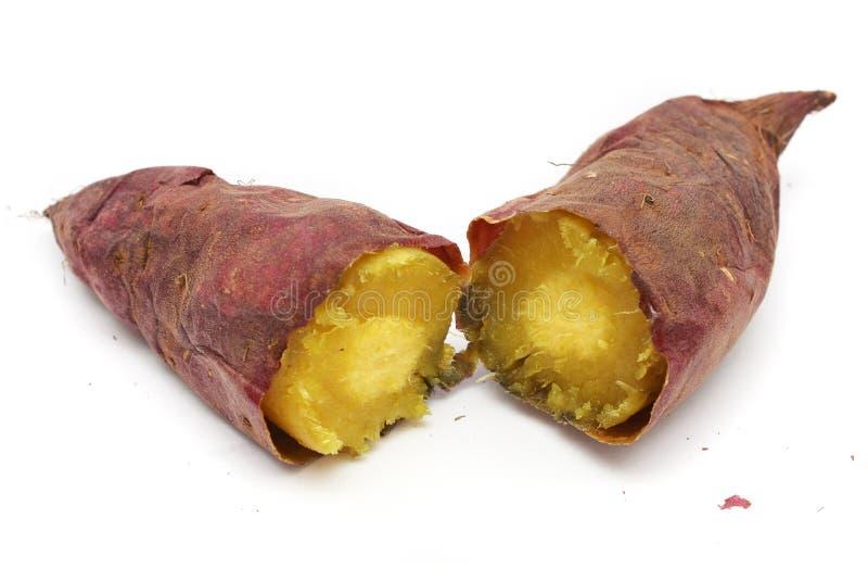 Cooked Purple Sweet Potato. A cooked purple sweet potato peeled into half stock images
