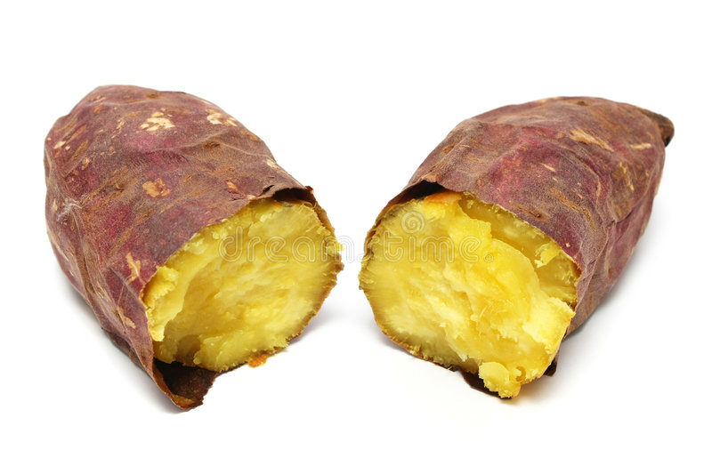 Cooked Purple Sweet Potato. A cooked purple sweet potato peeled into half royalty free stock images