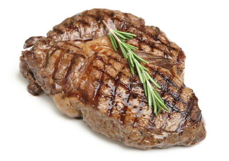 Cooked Rib-Eye Steak. On white royalty free stock photos