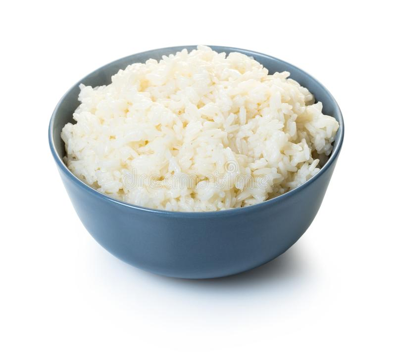 Cooked rice in a bowl. On white isolated background royalty free stock photo