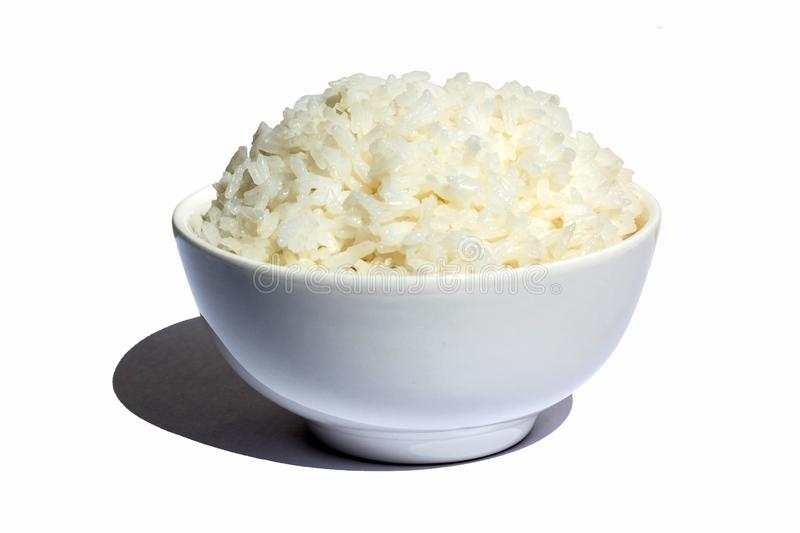 Cooked Rice in Bowl. Image of cooked rice in a white bowl with its shadow isolated in white background royalty free stock photo