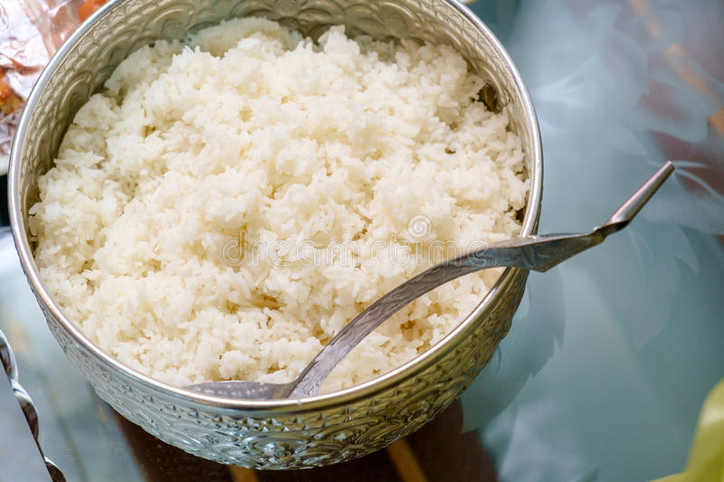 Cooked rice in the traditional Thai silver ware royalty free stock photos