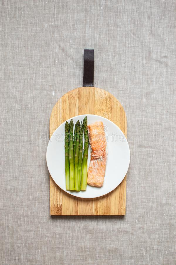 Cooked Salmon Fish Fillet with Asparagus, Healthy Food Concept, Top View. Linen Tablecloth stock photos