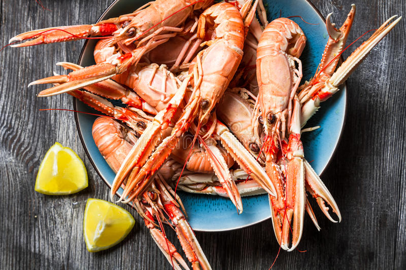 Cooked scampi served with lemon stock photo